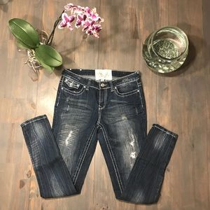 Dollhouse dark wash distressed skinny jeans